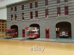 1/64 scale Manhattan Fire station for code 3's. Kit