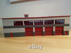 1/64 scale Modern Four Bay Fire Station Drive Through Bays. Unpainted Kit